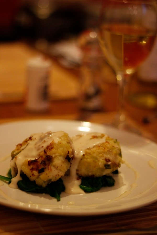 Fishcakes with spinach and white sauce