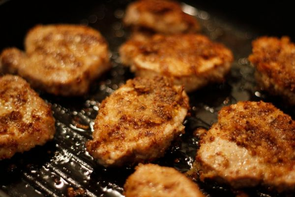 Pork cooking in griddle pan