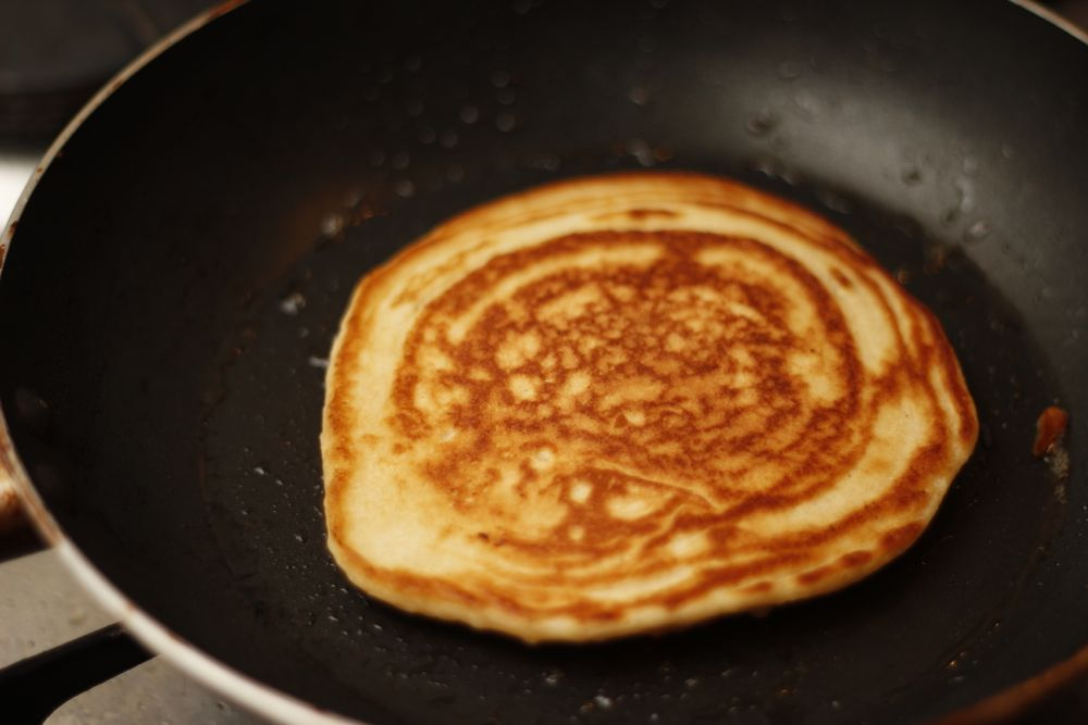 Apple and bacon pancakes cooking